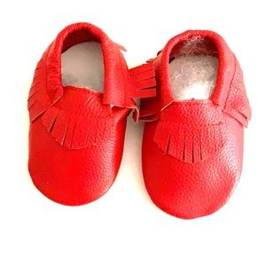 Red baby leather moccasins